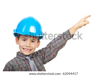 Small architect boy with helmet pointing up to copy space and smiling with his missing teeth isolated on white background - stock photo