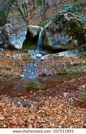 small autumn brook in a mountains - stock photo