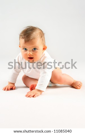 small baby girl sitting over white background - stock photo