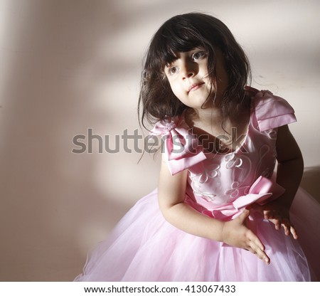 Small baby in summer pinky bride dress - stock photo