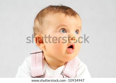 small baby is very curious what is going on - stock photo