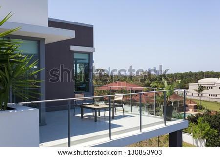 Small balcony overlooking the city - stock photo