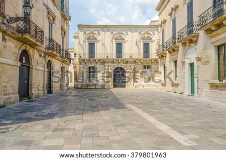 Small baroque square with beautiful architecture in central Lecce, Salento, Apulia, Italy - stock photo
