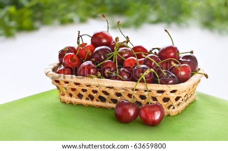 Small basket with fresh cherry - stock photo