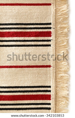 Small bathroom carpet of rough textile with fringe - stock photo