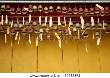 Small Bell on the yellow wall - stock photo