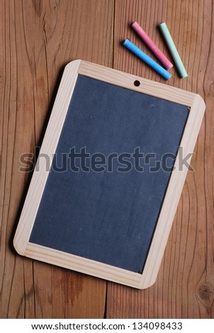 small blackboard on the wooden table - stock photo
