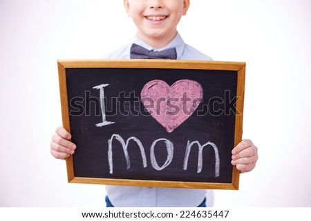 Small blackboard with love declaration held by a boy - stock photo