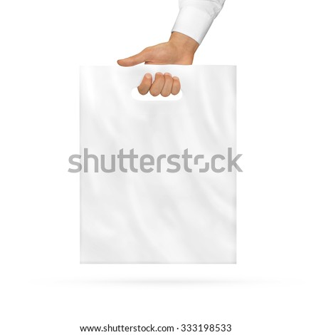 Small blank plastic bag mock up holding in hand. Little empty polyethylene package mockup hold in hands. Consumer mini pack ready for logo design or identity presentation. Product food packet handle. - stock photo