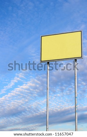 Small blank sign against deep blue sky background - stock photo