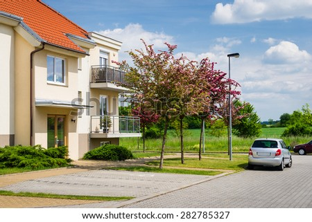 Small block of flats in green nature - stock photo
