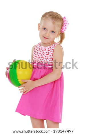 Small blonde girl standing with the ball in his hands on the white on the background - stock photo
