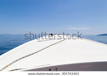 Small boat on a sunny day - enhanced colors - stock photo