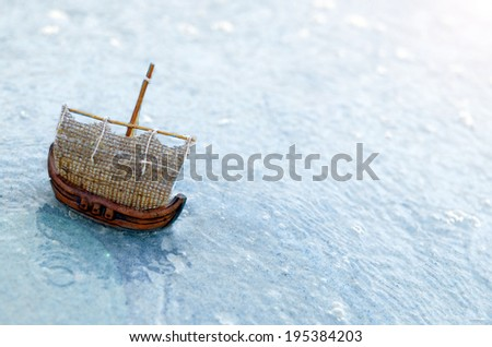 Small boat on blue water - stock photo