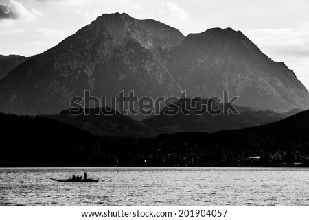 Small boat on the lake in mountains Austria - stock photo