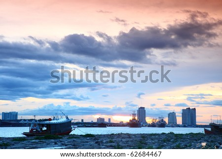Small boat with a beautiful fall sunset sky - stock photo