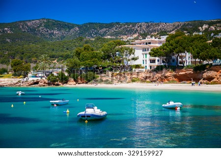 small boats in front of the beach in Portals Nous, Mallorca, Spain - stock photo