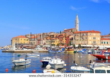 Small boats inside the harbor of an old Venetian town, Rovinj, Croatia - stock photo