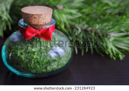Small bottle of bath salt with pine extract - stock photo