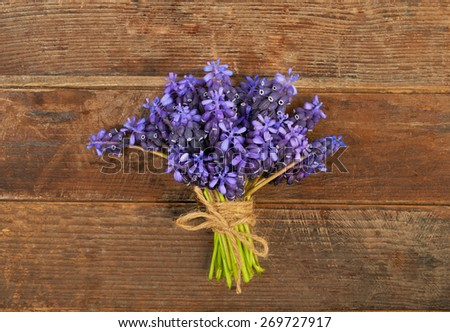 Small bouquet of hyacinth on a wooden table background - stock photo