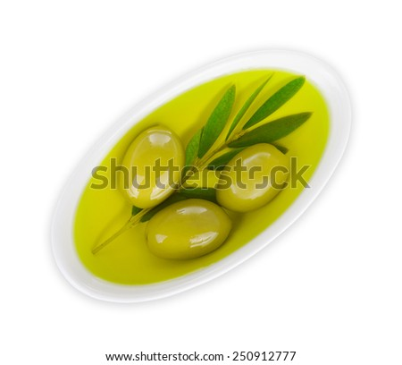 small bowl with olive oil with a small twig with olives isolated on white background - stock photo