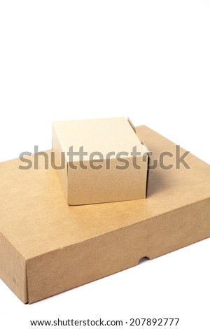 Small box is placed on large box.boxes on white isolated background. - stock photo