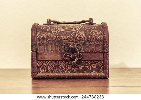 small box old-fashioned on the wood table - stock photo