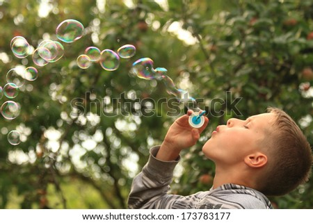 small boy and bubbles - stock photo