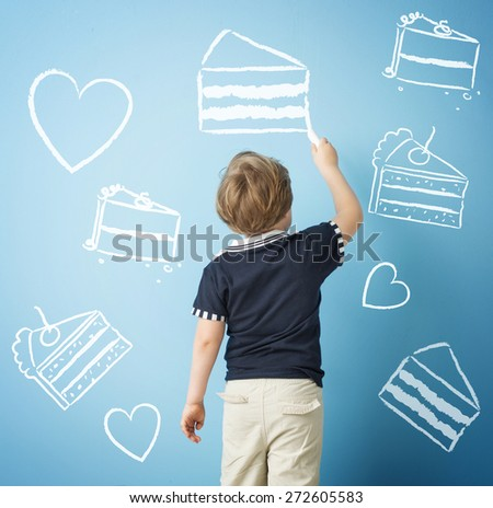 Small boy drawing - stock photo