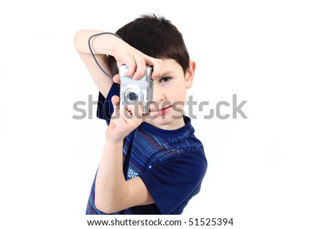 small boy photographing vertical with digital camera on white background - stock photo