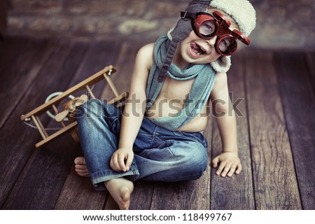 Small boy playing - stock photo