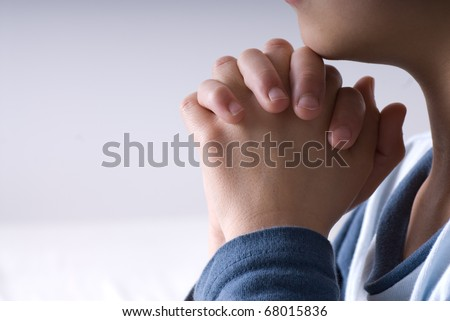 Small boy praying before going to bed - stock photo