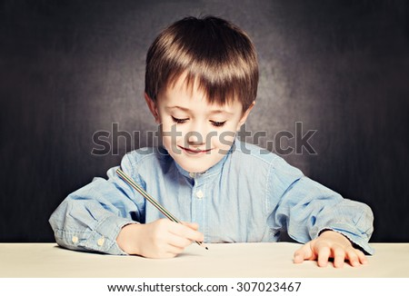 Small Boy Pupil Painting. Child with Pencil - stock photo