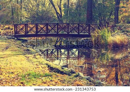 small bridge in the park - stock photo
