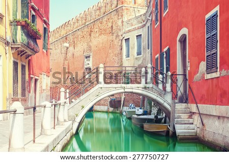 Small bridge over a canal in Venice, Italy. - stock photo