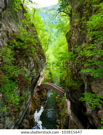 Small bridge over river at Gorges de l'Areuse, Neuchatel, Switzerland - stock photo