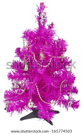 Small bright pink Christmas tree with decorations on white background - stock photo