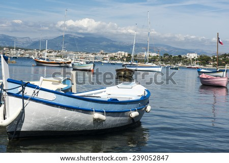 Small, brightly coloured, traditional french fishing boats called Pointus moored up in the pretty Mediterranean port of Sanary-sur-Mer, Var, France - stock photo