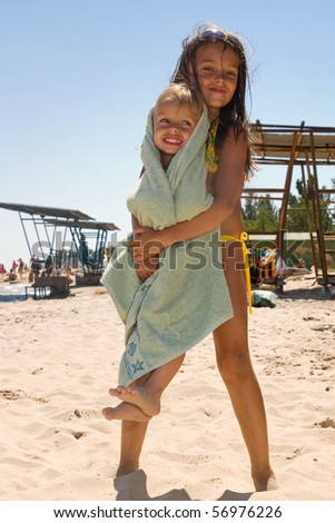 Small brother and sister spending their vacation at the summer resort - stock photo