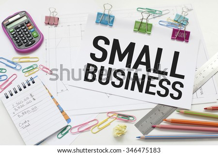 Small Business / Conceptual background with calculator and papers - stock photo