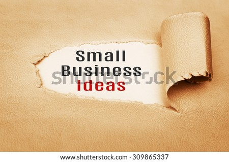 Small Business Ideas Concept written behind torn paper - stock photo