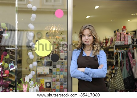 small business owner in front of gift store - stock photo