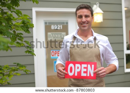"Small Business owner with ""open"" sign - stock photo"