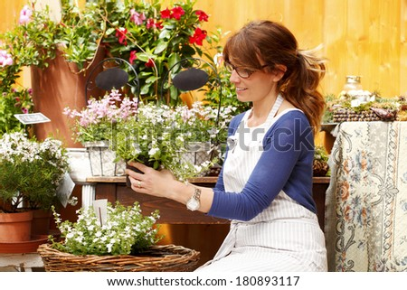 Small business owner working in her flower shop. - stock photo