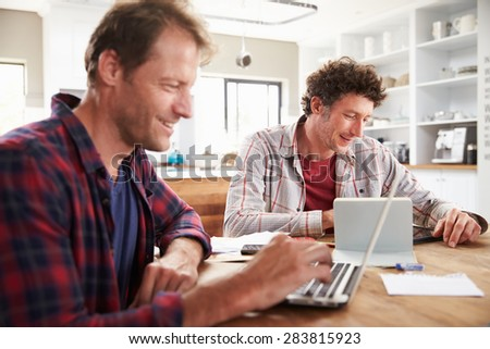 Small business partners using computers at home - stock photo