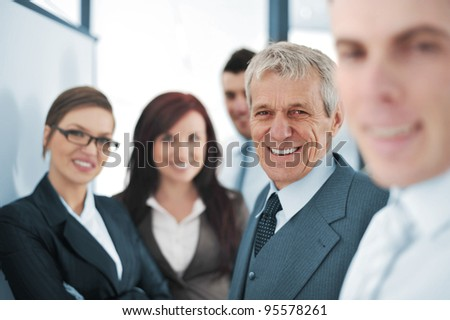 Small business team in the office in front of a whiteboard - stock photo