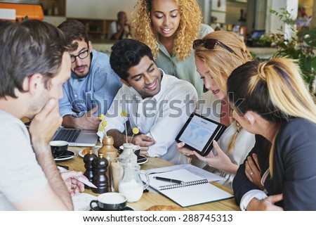 Small Business team meeting global sharing economy tablet touchscreen cafe - stock photo