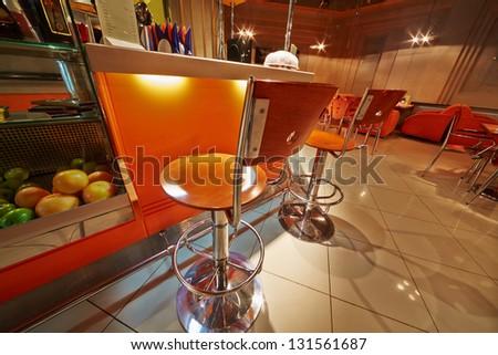 Small cafe-bar in orange tones - stock photo
