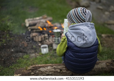 Small Camping Tent Illuminated Inside. Night Hours Campsite. Recreation and Outdoor Photo Collection. - stock photo