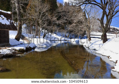 Small Canal Surrounded with Snow at Gassho-zukuri Village/Shirakawago - stock photo